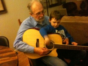 GG son Zachary learning guitar